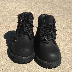 Timberland all black boots son!